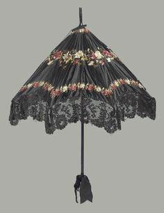 Large black satin parasol embroidered with polychrome silks, red and white predominating, in three horizontal bands of flowers, black machine made lace ruffle around e … Victorian Era, Victorian Fashion, Vintage Fashion, Victorian Costume, Victorian Ladies, Classic Fashion, Gothic Fashion, Fashion Fashion, Vintage Umbrella