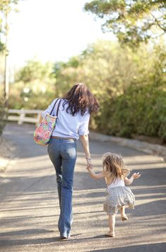 mommy and daughter; little girl reminds me of Leanne jumping like that.. wish I had mama's figure lol
