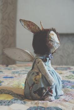 Lily is a one of a kind art doll Rabbit ... With wings.She is made from papier mache and rescued cloth.  She wears vintage 1950s pussy willow fabric Pantaloons. Has vintage fabric ears and wings ...