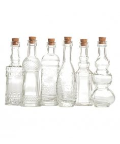 Something like this for the kitchen window sill... Love this Clear Glass Bottle Set by Koyal Wholesale on #zulily! #zulilyfinds