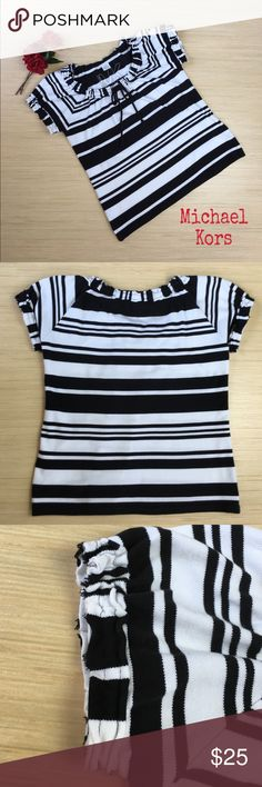 Michael Kors Top Size Large Give off a laid back and relaxed vibe with this preloved black and white striped Michael Kors top. The short sleeves and neckline of this top have a distressed look. The neckline also has a tie with a keyhole right below. There is a 1 1/2 inch split at the hemline on both sides of the shirt separating the front from the back. This shirt is made of 100% cotton and is a size Large. Michael Kors Tops