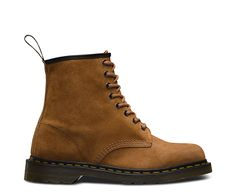 The first revolution happened in April 1960. That's when the original Dr. Martens 1460 8-eye boot rolled off the production line in Northamptonshire. Designed with a unique performance technology—air cushioned soles—the boot brought a new level of comfort to England's working class. This season, the classic unisex boot is updated in a new leather: Soft Buck, a genuine pigskin Nubuck with a very soft feel. The 1460 unisex boot has all the classic Doc DNA, like yellow stitching, grooved sides…