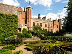 back of Charlecote Park house and the formal gardens