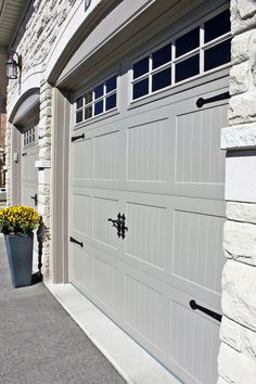 C.H.I Carriage House collection, model #5983 in Sandstone, CHI Carriage style garage doors in Sandstone, Carriage style wrought iron garage door decorative hardware