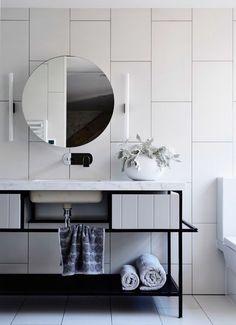 zen Bathroom Decor oversized white tiles create a wow effect in this bathroom and black grout helps to accent them Zen Bathroom Decor, Bathroom Mirror With Shelf, White Bathroom Tiles, Bathroom Interior Design, Modern Bathroom, Small Bathroom, Modern Vanity, Bathroom Inspo, White Tiles Black Grout