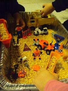 Construction Sensory bin with Popcorn