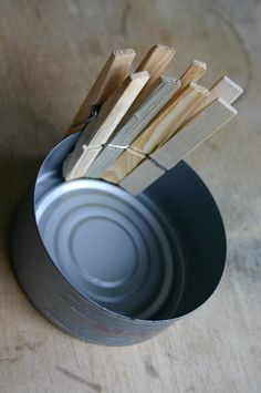 clip clothes pins around a cleaned out tuna can to make a nifty tealight candle holder