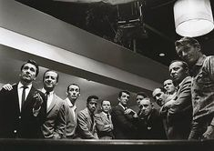 "Photograph by Sid Avery - The original cast of ""Ocean's 11″ (1960) – from left to right: Nick Conti, Jerry Lester, Joey Bishop, Sammy Davis Jr., Frank Sinatra, Dean Martin, Peter Lawford, Akim Tameroff, Richard Benedict, Henry Silva, Norman Fell and Clem Harvey"