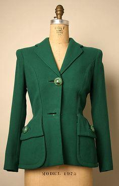 Jacket.  Elsa Schiaparelli (Italian, 1890–1973).  Date: ca. 1952. Culture: French. Medium: wool, metal, plastic, synthetic. Dimensions: Length at CB: 24 1/2 in. (62.2 cm).