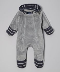 Layered for warmth and style, this darling piece features a cuddly hood, snaps around both legs and foldover feet and hand mitts to keep kids covered from head to toe.Cotton / polyesterMachine wash; tumble dryImported