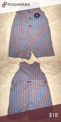 Carter's red and blue striped romper In great condition, in brand new condition. Adorable romper with red and blue buttons and stripe pattern and cute sail boat on one side. Carter's Other