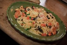Angel Hair with Artichokes - Angel hair sautéed with Roma tomatoes, garlic, capers, basil, black olives and parmesan. This is the recipe for the same dish at Carino's Restaurant (just omit shrimp to make it vegetarian)