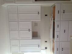 Kitchen with stacked white cabinets