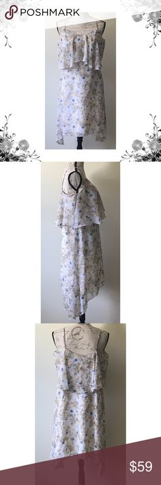 """{BCBGeneration} Floral Blossom Asymmetric Dress Chest across measures approx 28"""". Length is approx 37"""". Floral print. Popover. Asymmetric hem. Adjustable spaghetti straps. Polyester. Price tag has been cut but is still intact. Bundle for discounts! 5lb bundle weight limit. Thank you for shopping my closet!   Bin BCBGeneration Dresses Asymmetrical"""