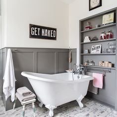Grey and white bathroom with slipper bath and panelled shelves