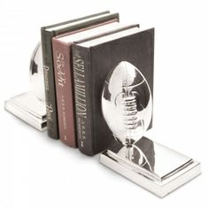 Rugby Ball Bookends - Our stunning new Rugby Ball Bookends make a great accessory for anybody who loves the gentleman's sport.   Our bookends are available in three different designs also including Cricket - the perfect adornments for any sports loving home. Stand your books with style. http://www.petersilk.co.uk/product.php/433/rugby-ball-bookends