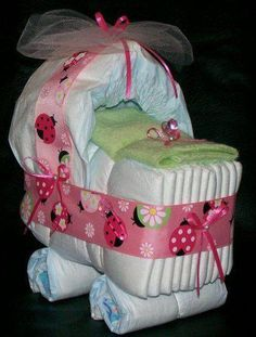 Such a cute Baby Shower Idea!! It's all diapers, even the canopy is an unfolded diaper! Add a cute ribbon and blanket and Voila!
