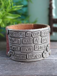 Ever Designs Jewelry - Paw Print Leather Cuff, $60.00 (http://www.everdesigns.com/paw-print-leather-cuff/)