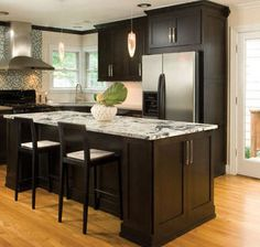 love the countertop choice.  long center island with storage.