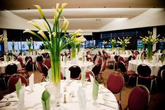 Calla lily centerpieces. Imagine a treatment similar to this in the silver trumpet vase.