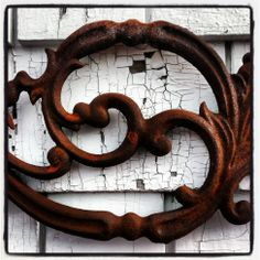 Detail of a salvaged cast iron panel salvaged from the railings and columns of an old New Orleans home.  Photo by Old House Chic.