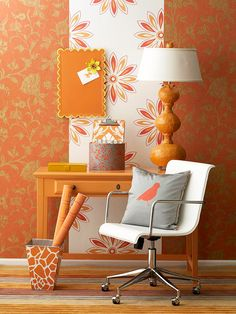 Tricks of the Trade  Wallpaper can disguise a wall's imperfections and manipulate spaces with visual tricks. Here, a stripe of white and orange wallpaper in front of an orange and gold floral pattern hides dents on the imperfect wall.  Let http://lelandswallpaper help you find the right combination.