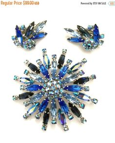 Sherman Brooch and Earring Demi, Sapphire and Peacock Blue Aurora Borealis, Round and Marquise Cut Crystals, Rhodium Plated by Vintageimagine on Etsy https://www.etsy.com/listing/259618639/sherman-brooch-and-earring-demi-sapphire