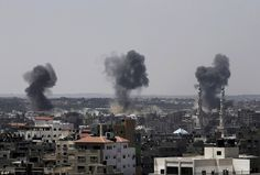Under fire: Smoke rises after Israeli missile strikes hit the northern Gaza Strip this morning. A Hamas website says Israel has fired missiles at the homes of four of its senior leaders as it resumed bombing Gaza, following a failed Egyptian cease-fire effort