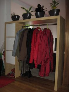 IKEA Hackers: wardrobe from EXPEDIT bookcase or entertainment center - perfect for a room divider in a small house or for his her closet space Kallax 4x4, Ikea Kallax Shelving, Ikea Expedit, Retro Furniture, Furniture Sale, Sofa Furniture, Cheap Furniture, Furniture Design, Furniture Dolly