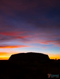 Uluru at sunrise - Outback Australia's natural icon. See more photos and tips on our blog!