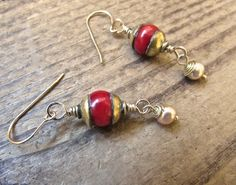 Lovely red Tibetan beads with 14k gold filled wire work freshwater pearls. 14k gold filled ear wires and brass caps. SOLD