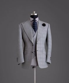 Grey Prince of Wales wide lapel suit.