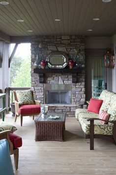 Outdoor Living Porch - 80 Breezy Porches and Patios - Southernliving. This space mirrors both the function and the layout of an interior living room. An outdoor sofa and club chairs are arranged around a central hearth.  Tour the Hemlock Springs Idea House