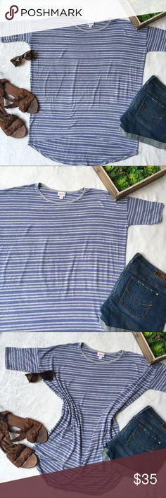 LuLaRoe lavender/grey striped Irma tunic top Soft and oh so comfy oversize Irma tunic from LuLaRoe. Alternating bluish lavender and grey stripes and a high low hem make this the perfect top to wear over your favorite LuLaRoe leggings! Excellent condition, no flaws. Size Small. LuLaRoe Tops Tunics