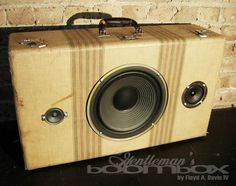 Illinois artist Floyd A. Davis IV takes vintage suitcases, steamer trunks, train cases and everything else inbetween, installs a set of speakers and an audio input, and offers his creations as functional and unique objets d′art.