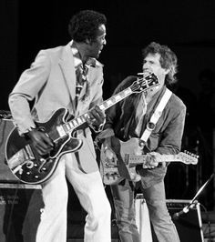 Keith Richards on stage with Chuck Berry at the Chicago Blues Festival in Grant Park, on this day in 1986
