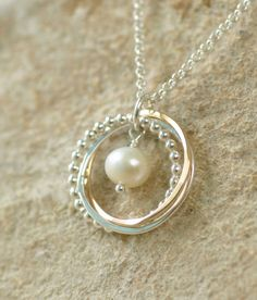 This three linked rings necklace is a popular 30th birthday gift and is perfect for a sisters or mothers necklace, as each ring is different,