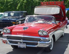1958 Ford Fairlane 500 Skyliner - Red & White Convertible.....my very first car...I loved the leather interior and top...wish I never sold it!!!