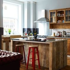 Browse hundreds of inspirational design ideas and images for your kitchen - I like the red stools!