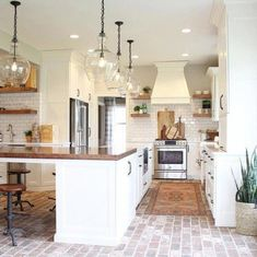 brick flooring Make a subtle statement with your lighting styledbysorrells does it beautifully with our Flynn Oversized Recycled Glass Pendants Tag potterybarn to share your style with us! Modern Farmhouse Kitchens, Farmhouse Kitchen Decor, Home Decor Kitchen, New Kitchen, Home Kitchens, Kitchen Ideas, Awesome Kitchen, Pottery Barn Kitchen, Farmhouse Style