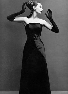 August 1955    		Wearing an evening dress by Hubert de Givenchy. Photographed by  Richard Avedon.