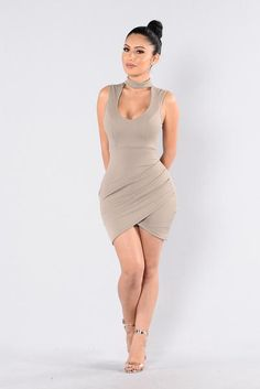 - Available in Rust and Mocha - Choker - Scoop Neckline - Keyhole Back - Tulip Hem - Ruching Detail - 96% Polyester, 4% Spandex