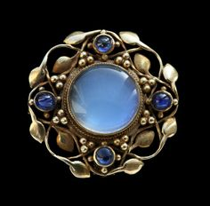 Gold, sapphire and moonstone brooch.