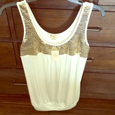 Forever 21 Cream Bling Gold NWT Tunic Tank Top Forever 21 Cream Bling Gold Sequins NWT Tunic Tank Top - never worn. Size M. Super soft and cute! Forever 21 Tops Tank Tops