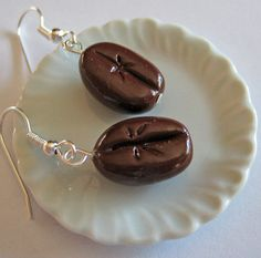 Handmade Miniature Coffee Bean Earrings are for all java lovers out there. The handmade Coffee Beans are made from polymer clay and then glazed. Polymer Clay Miniatures, Polymer Clay Charms, Polymer Clay Earrings, Resin Jewelry, Handmade Jewelry, Cute Jewelry, Unique Jewelry, Coffee Gifts, Coffee Drinks