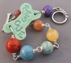 Rescue dog bone bracelet in mint green with a rainbow of gemstones. Silver dog collar and dog bone toggle clasp.  Handmade by For Love of a Dog