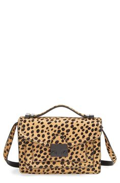 A spot-on balance of uptown chic and downtown edge makes this leopard print purse a must-have.