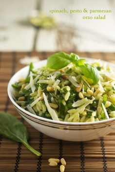 A simple, tasty salad of orzo with a homemade basil pesto, toasted pine nuts, shredded spinach & parmesan cheese.
