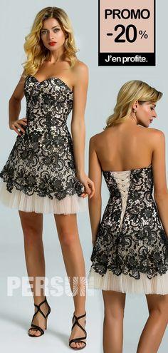 On a été fasciné par cette jolie robe bustier coeur à deux tons. La guipure en noir sur la doublure en champagne clair dessine bien votre silhouette en valeur. Les tulles au niveau de l'ourlet rajoute encore de la douceur et du romantisme à la tenue.