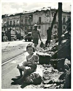 Little girl holding a small flag, selling bananas, Manila, Philippines Shortly after liberation of the city. Philippine Holidays, Intramuros, Small Flags, Days In February, Ww2 Photos, Manila Philippines, The Old Days, Pearl Harbor, Vintage Pictures